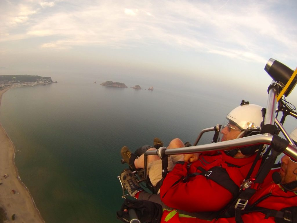 Martin Heng flying over the Medes Islands in paratrike